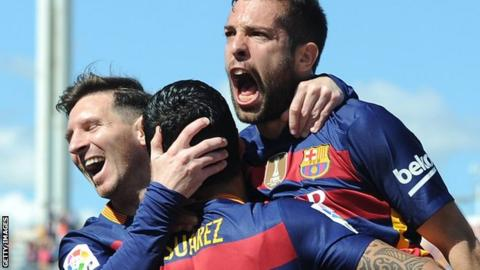 Barcelona players celebrate a Luis Suarez goal against Granada