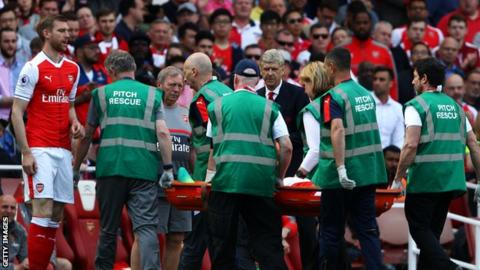 Gabriel is carried off on a stretcher