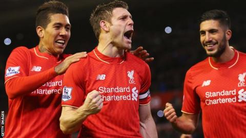 James Milner celebrates scoring against Swansea