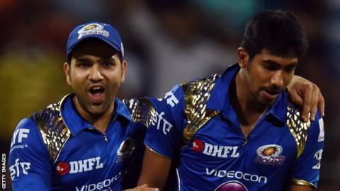 Mumbai Indians captain Rohit Sharma (left) with fastbowler Jasprit Bumrah, who took 3-7
