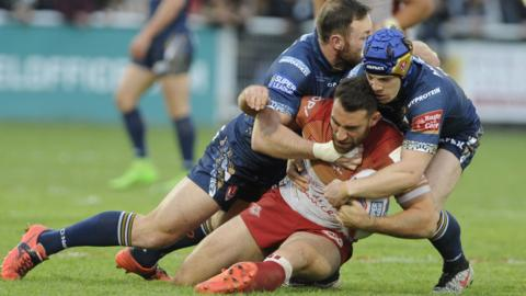Catalan's Thomas Bosc tacled by James Roby and Thea Fages
