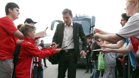 Slaven Bilic signs autographs