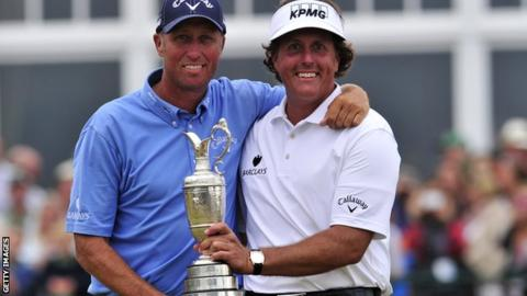 Mackay and Mickelson celebrate with the Claret Jug after winning the Open in 2013