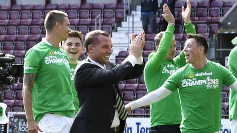 Mikael Lustig (left) celebrates with Celtic manager Brendan Rodgers and his team-mates