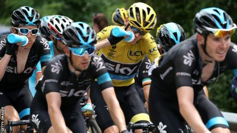Geraint Thomas (left) and Luke Rowe (right) shepherd Team Sky leader and yellow jersey holder Chris Froome during the 2015 Tour de France