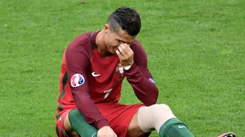Real Madrid and Portugal forward Cristiano Ronaldo reacts after being injured in the Euro 2016 final
