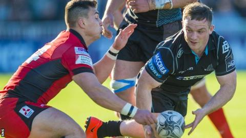 Glasgow's Nick Grigg (right) tries to hold onto the ball against Edinburgh