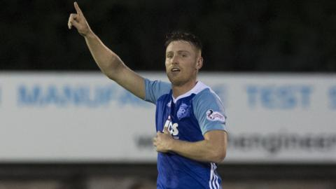 Rory McAllister celebrates his late winner against Hearts