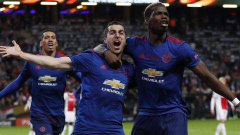 Henrikh Mkhitaryan celebrates with Paul Pogba
