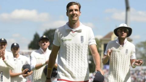Steven Finn leads England off after their win