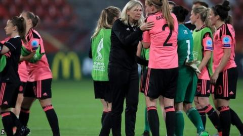 Scotland's head coach Anna Signeul (centre) comforts Vaila Barsley after the defeat