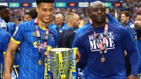 Adebayo Akinfenwa (right) celebrates