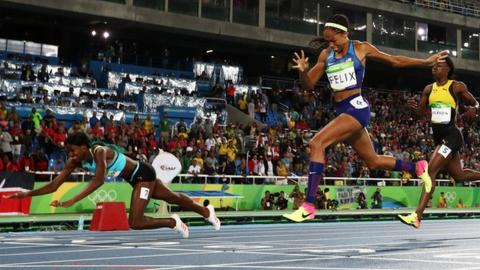 Bahamian sprinter's dive at finish line dethrones Allyson Felix in 400