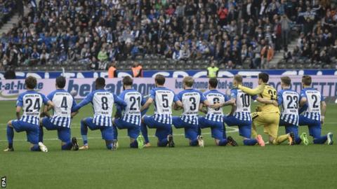 Hertha Berlin soccer players kneels before game in solidarity with National Football League  players