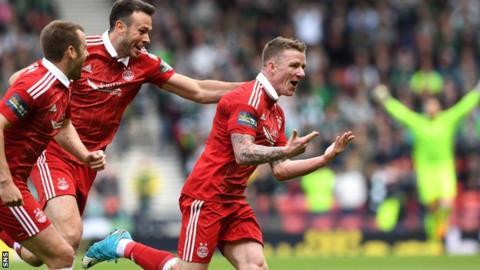 Jonny Hayes celebrates