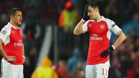 Mesut Ozil looks disconsolate during Arsenal's Champions League defeat by Barcelona