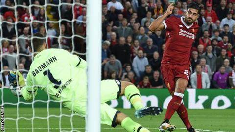 Free-scoring Liverpool reach Champions League group stage
