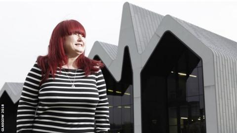 Izzy Conway, Glasgow 2018 volunteer champion, pictured in front of the city's Riverside Museum