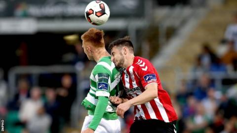 Gary Shaw of Shamrock Rovers and Derry City's Aaron Barry in aerial action at Tallaght Stadium