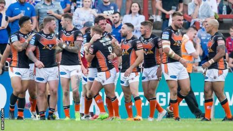 Castleford celebrate Grant Millington's try against Wakefield