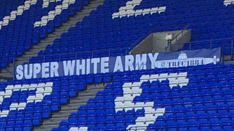 Super White Army banner at Tranmere Rovers ground