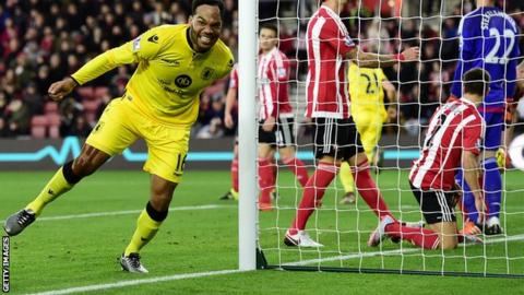 Joleon Lescott celebrates scoring for Aston Villa