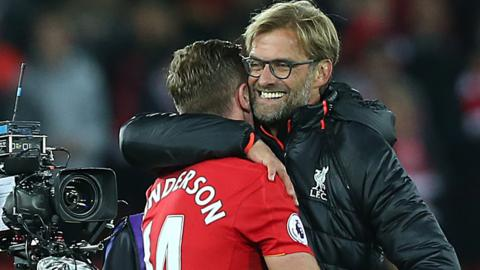 Jurgen Klopp and Jordan Henderson celebrate
