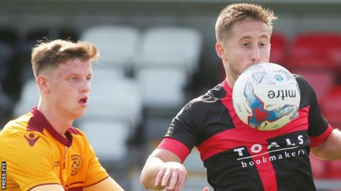 Jordan Armstrong in action against Michael Carvill of Crusaders