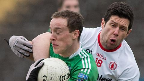 Fermanagh's Che Cullen battles with Tyrone's Sean Cavanagh in this year's Dr McKenna Cup semi-final