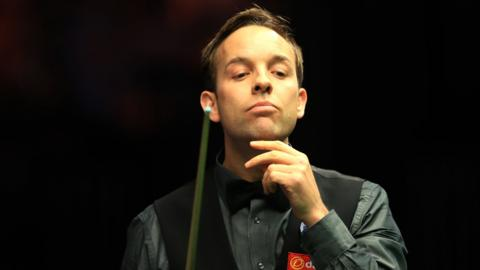 Ali Carter reacts during the match