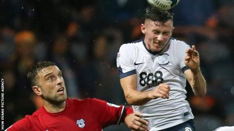 Rickie Lambert (left) challenges Alan Browne