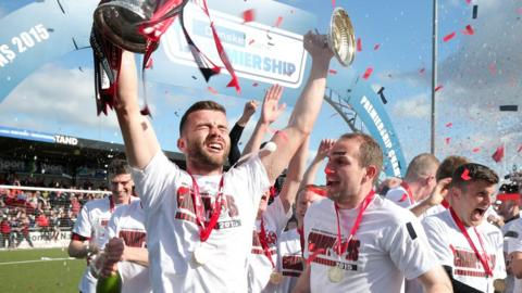 Crusaders captain Colin Coates lifts the Gibson Cup after the Shore Road team won the Irish Premiership in April