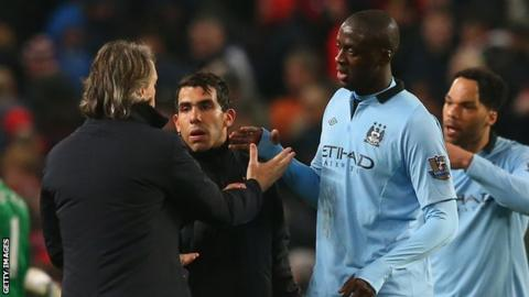 Former Manchester City boss Roberto Mancini and Yaya Toure