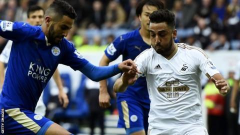 Riyad Mahrez of Leicester City takes on Swansea City's Neil Taylor