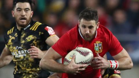 Tommy Seymour runs with the ball