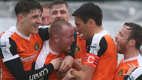 Kyle McVey is congratulated by his Carrick team-mates after scoring in the Premiership play-off win over Institute