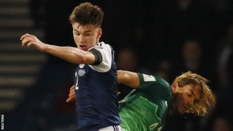 Scotland's Kieran Tierney and Slovenia's Rene Krhin