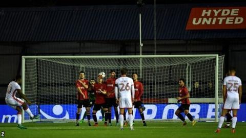 Chuks Aneke scores for MK Dons against Hyde United