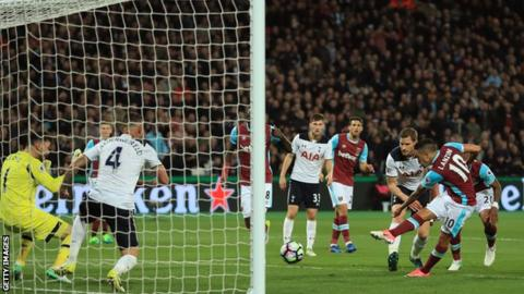 West Ham's Manuel Lanzini scores from close range against Tottenham last season.
