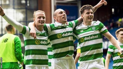 Leigh Griffiths, Scott Brown and Kieran Tierney celebrate Celtic's win at Ibrox