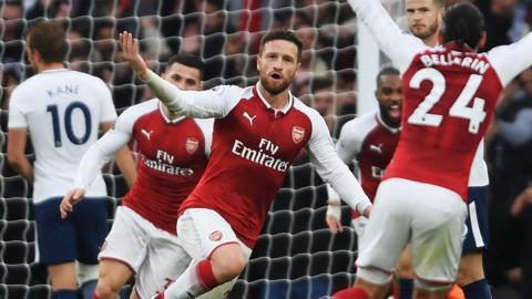 Shkodran Mustafi celebrates scoring for Arsenal against Tottenham