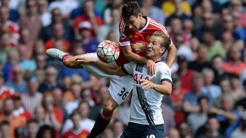 Tottenham's Harry Kane and Manchester United's Matteo Darmian vie for the ball in the reverse fixture.