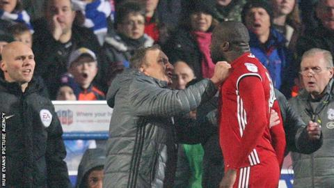 Cardiff defender clashes with manager Warnock after red card