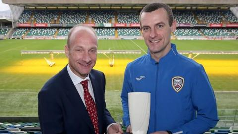 Coleraine manager Oran Kearney receives his award from BBC Sport NI's Stephen Watson