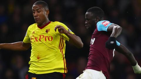 Cheikhou Kouyate of West Ham and Watford's Marvin Zeegelaar challenge for the ball.