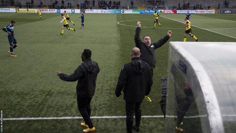 The Edinburgh City bench react with delight as Lewis Allan's shot gave the visitors the lead in the 86th minute