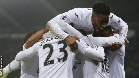Swansea City celebrate a goal against Leicester City