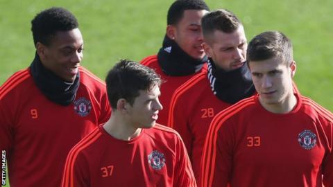 Donald Love (number 37) and Paddy McNair (number 33)