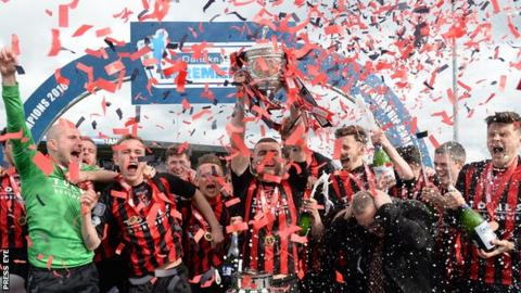 Crusaders celebrate winning the Premiership title for the second straight year