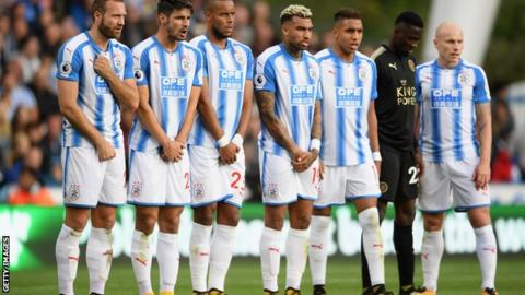 Huddersfield Town players line up in a defensive wall